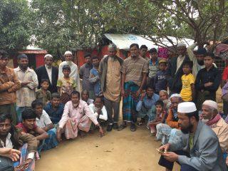 hommes d'un villages réunis en cercle